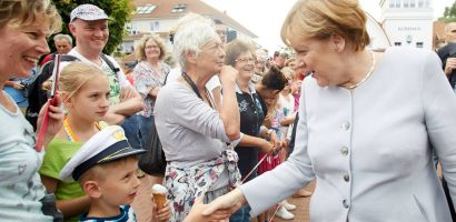 German Chancellor Angela Merkel Soaked in beer Video