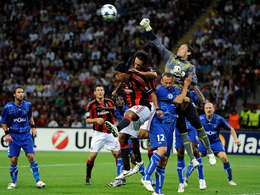 milan back with 2-0 win over auxerre