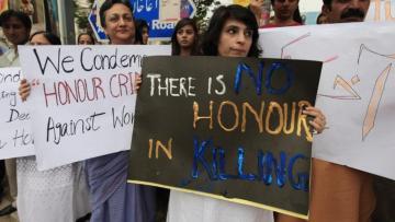 Pakistani women taking street against honor killing of women in Pakistan.