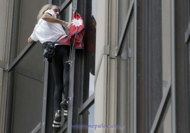 Spiderman' scales Paris tower for Nepal quake victims