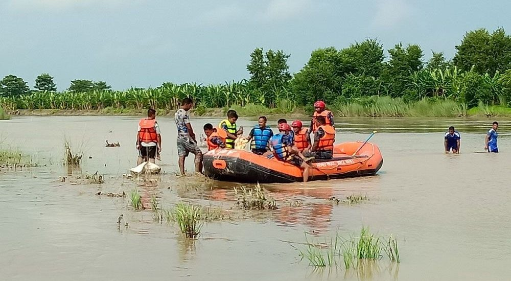 Search and rescue unit of Nepal Police and Army searching for the victims of Boat capsize at Lalbakaiya river.